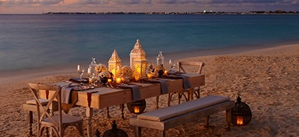 Table set for dinner on beach at the Marriott Grand Caymen