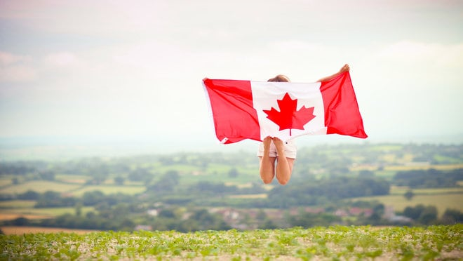 Girl jumping with Canada Flag