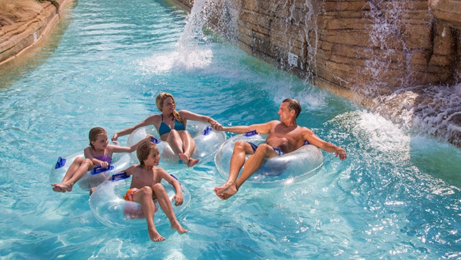 Kids play in lazy river at Gaylord Texan Resort