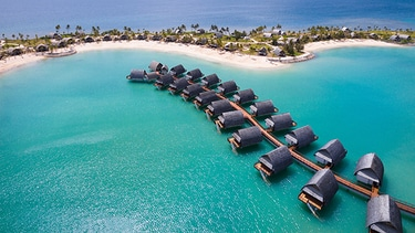 Bird S Eye View Of Caribbean Beach And Overwater Bungalows