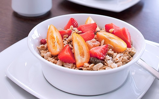 Bowl of granola with fresh sliced fruit