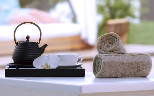 Catering tray with Japanese tea pot, cup and white orchid