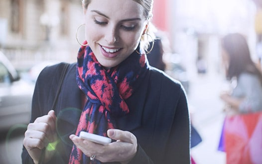 Young, professional woman looking at her mobile phone