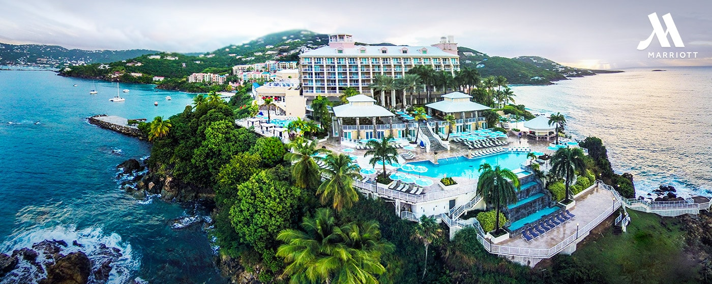 Aerial view of lush tropical island setting and multiple swimming pools at Frenchman's Resort