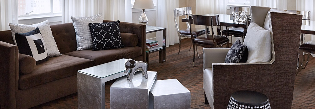 Hotel suite with seating area and luxurious, modern décor