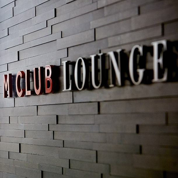 A sign for the M Club Lounge
