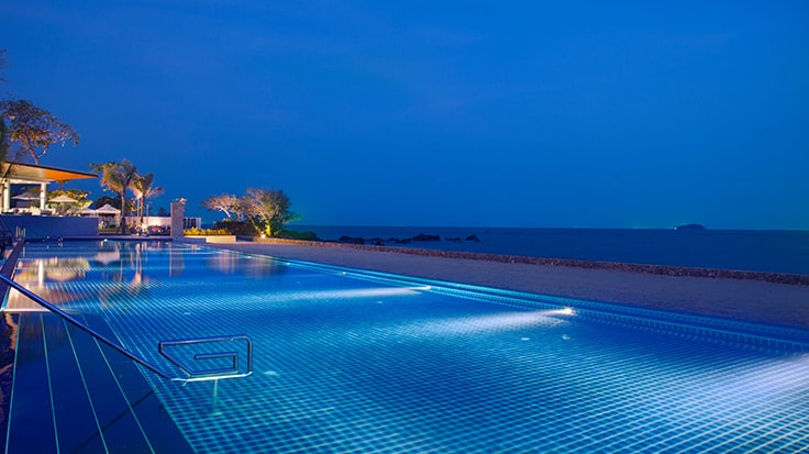 Evening view of a swimming pool overlooking the ocean