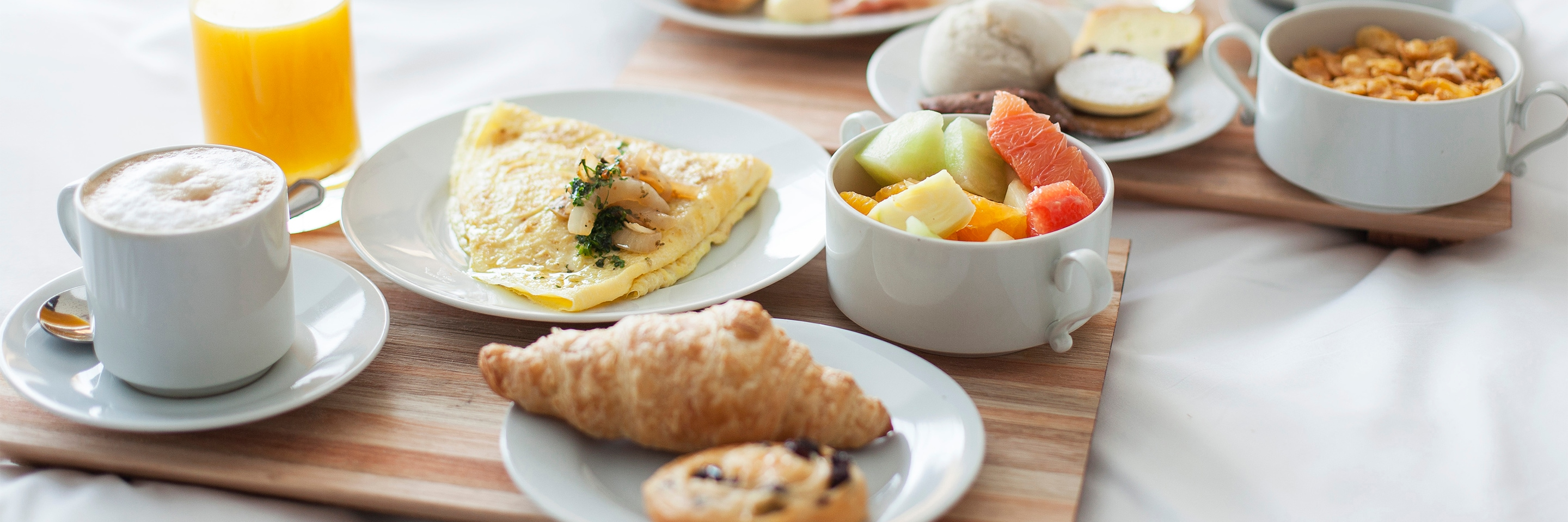 Hotel breakfast - omelet, fruit, croissant, coffee, orange juice and more.