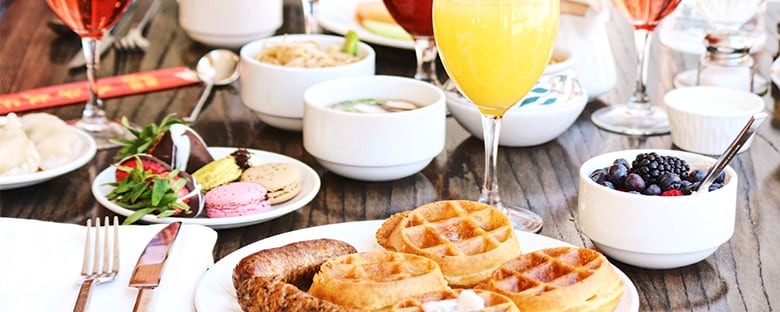 Brunch of waffles, macaroons and mimosas.