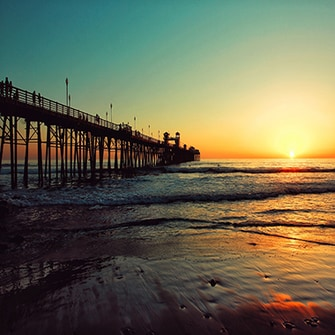 Ocean pier in California at sunset.