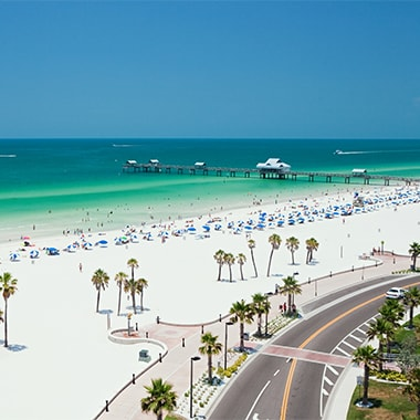 White sand beach in Florida with vacationers.