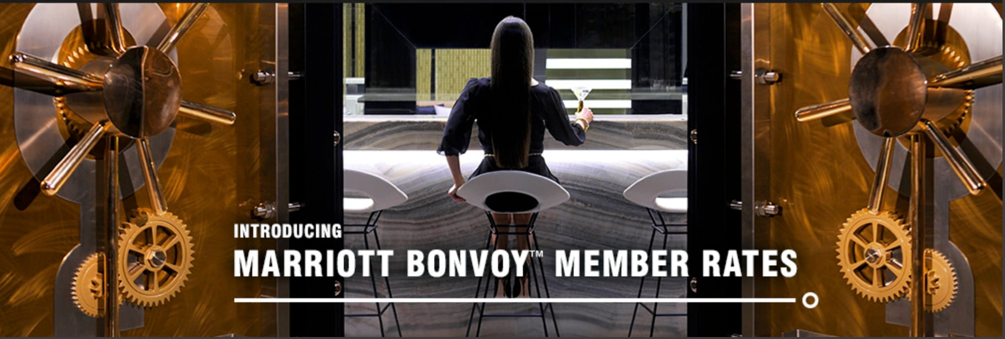 Woman sitting in a bar | Link to Marriott Bonvoy™ member rates page