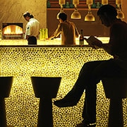 Person seated at bar in a hotel