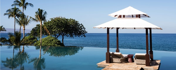 Infinity pool and cabana overlooking the ocean