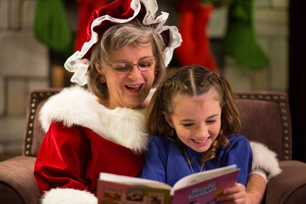 Mrs Claus reading to a little girl