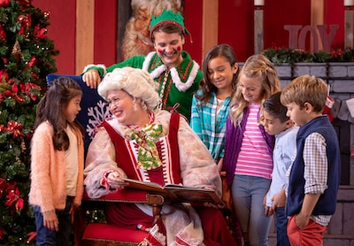 Mrs. Claus, elf and group of young children