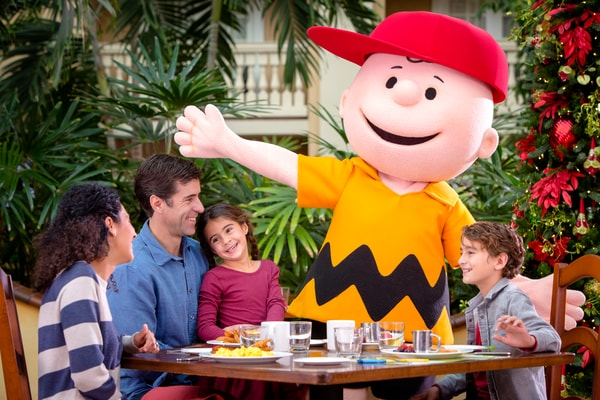 Family eating breakfast with Charlie Brown