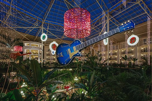 Giant guitar and other Christmas decorations in Gaylord Opryland atrium