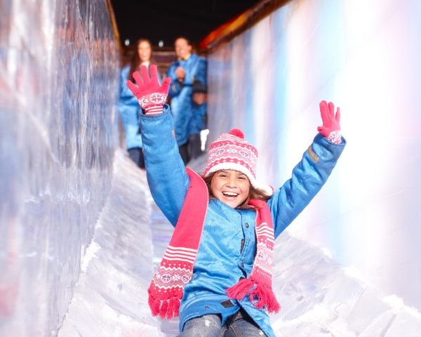 Girl going down ICE! slide at Gaylord Texan