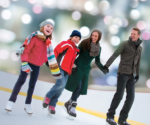 a family ice skating together