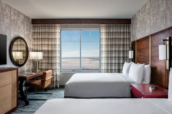 Hotel room with two beds and a view of the outdoors