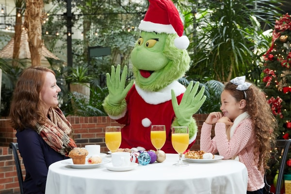 Two girls eating breakfast with Grinch