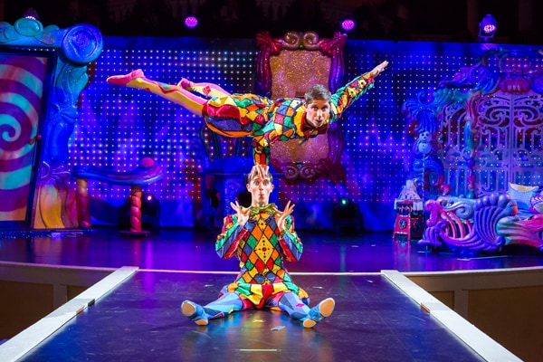 circus performers dressed in colorful costumes