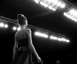 woman in gown on stage