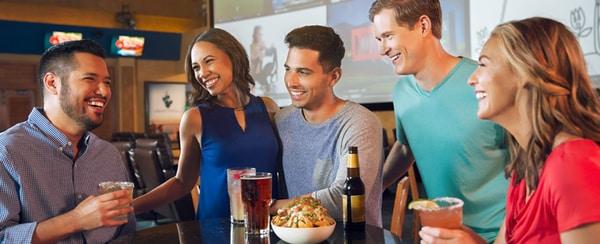 Group of friends at table at Texan Station Sports Bar at Gaylord Texan Resort