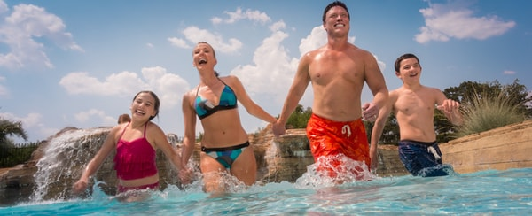 Family wading in Paradise Springs resort pool at Gaylord Texan