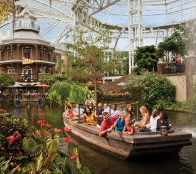 People on a boat in the atrium at Gaylord Opryland