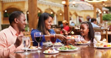 family eating a meal at Gaylord Palms
