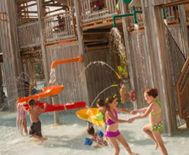 kids playing in the Treehouse water playground