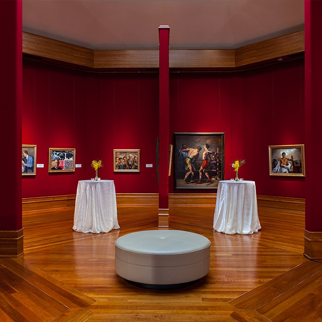 Two high tables in an art gallery setting