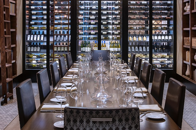 Long dining table in a wine cellar