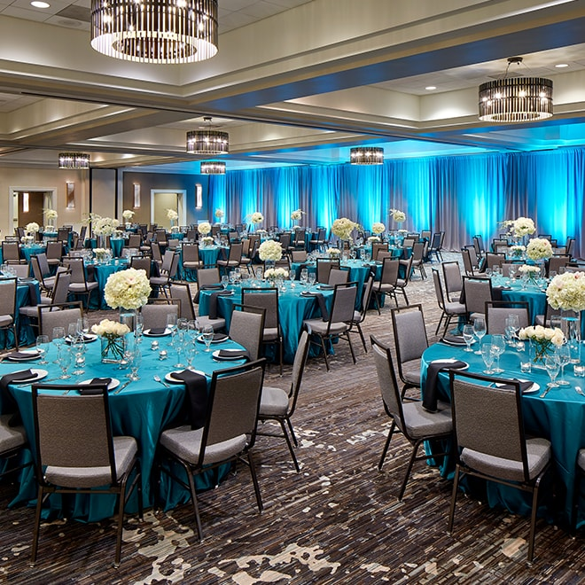 Ballroom with formally set round tables