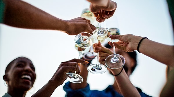 Beneath the hands of six people toasting champaign flutes at a Marriott event space