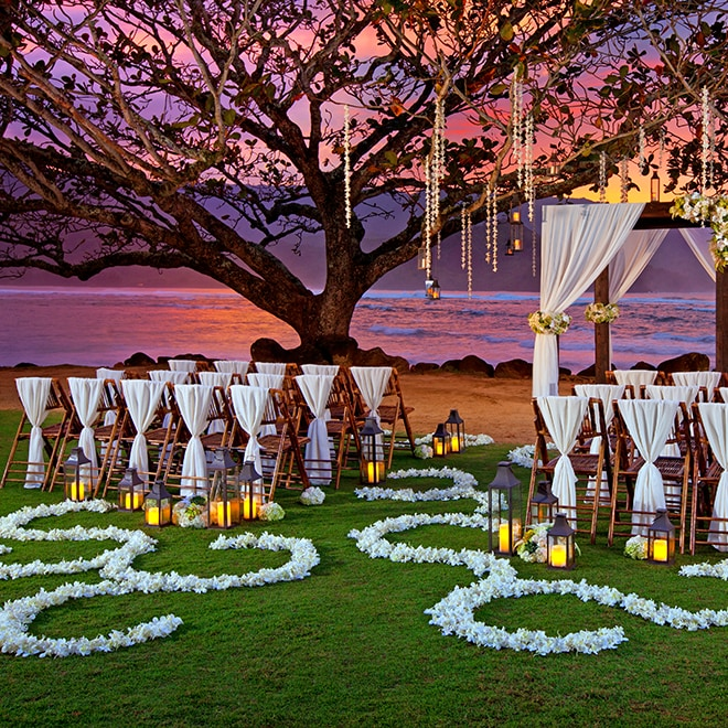 Outdoor oceanside wedding alter at dusk