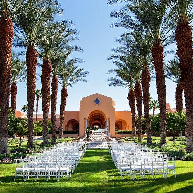 Outdoor wedding by a Spanish-style building