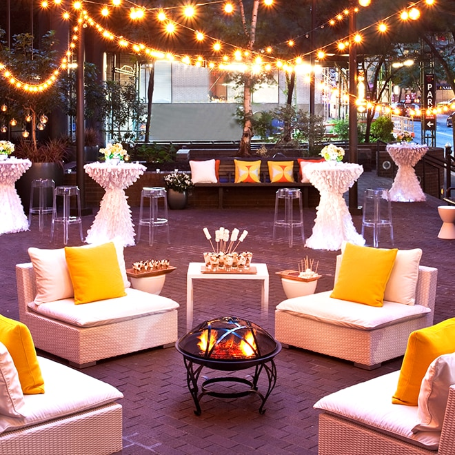 Outdoor reception with firepit and appetizers