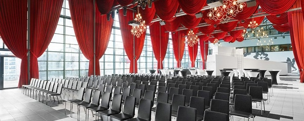 Meeting room and chairs with red drapes overhead
