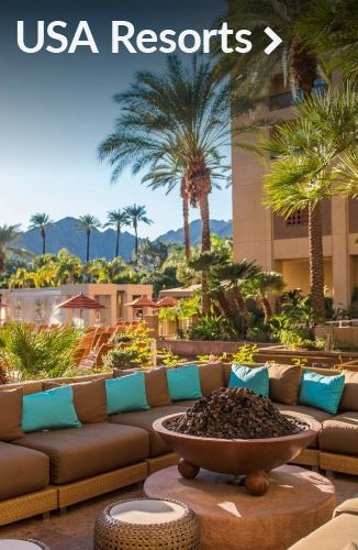 Hotel patio with sectional sofa and fire pit | Link to meeting and convention resorts in the USA