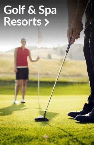 Woman holding flag stick as man prepares to putt | Link to golf & spa resorts