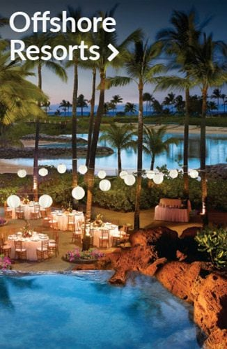 Overhead view of tables and a lagoon at night | Link to offshore resorts