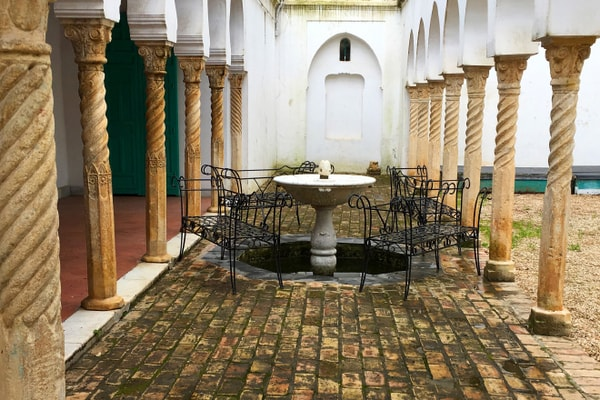 Lone fountain surrounded by columns in a Dar Hassan Pacha courtyard