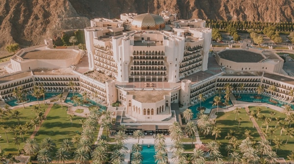 Aerial view of Al Bustan Palace, A Ritz-Carlton Hotel and surrounding mountains