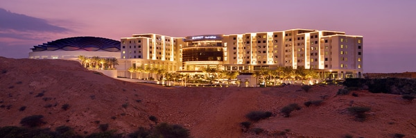 Exterior view of JW Marriott Muscat, including the hotel grounds