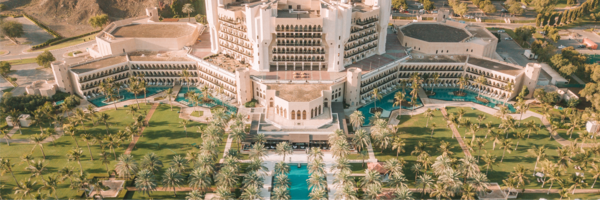 Overhead view of Al Bustan Palace, A Ritz-Carlton Hotel, including the hotel grounds