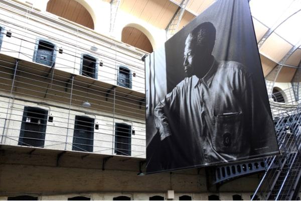 Large portrait of Nelson Mandela inside former prison