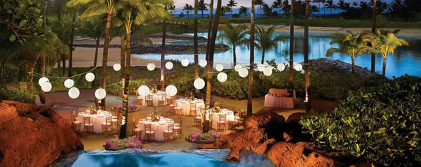 Overhead view of tables and a lagoon at night